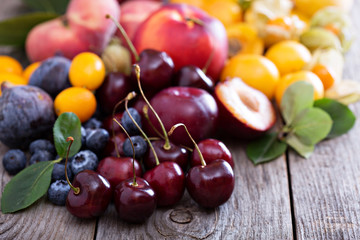 Fresh stone fruits on wooden table