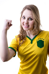 Brazilian fan celebrates on white background