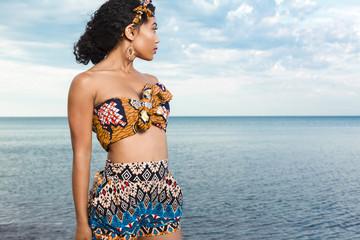 Beuatiful African American girl relaxing at the beach.