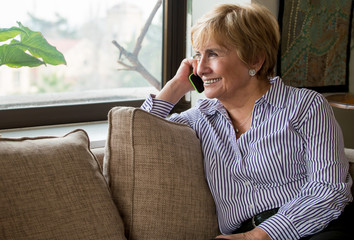 Happy mature woman on the phone