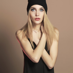 fashionable beautiful young woman in cap. blond girl in hat