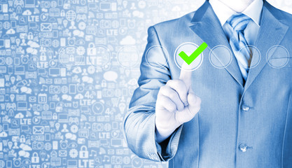 business man touching, pressing modern button with green ticking
