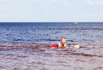 Girl and boy swimming in the lake