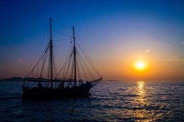 Cruising ship, sailing at sunset