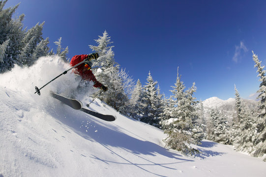 Expert skier on a sunny day in Stowe, VT, USA