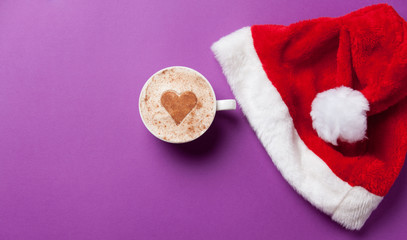 Cup of coffee and christmas hat
