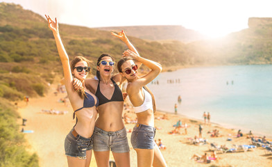 Three girls taking a picture at the beach