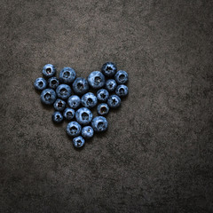 The heart of blueberry on a grey background