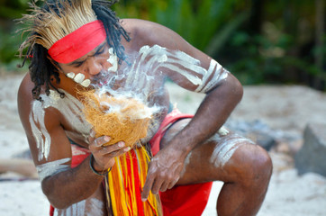 Yugambeh Aboriginal warrior man demonstrate fire making craf