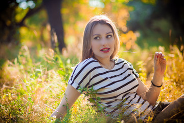 woman sitting on yellow grass