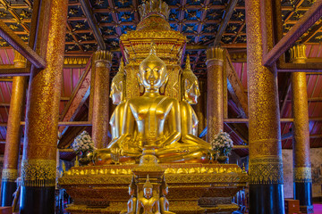 Golden Buddha image in temple of Wat Phumin in Nan, Thailand