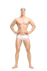 Young handsome swimmer posing in white swim trunks