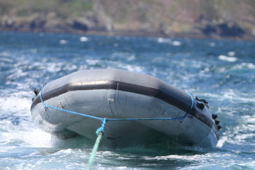 Inflatable boat being towed