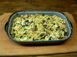 Baked pasta.Baked pasta with spinach, salami, eggs and cheese.