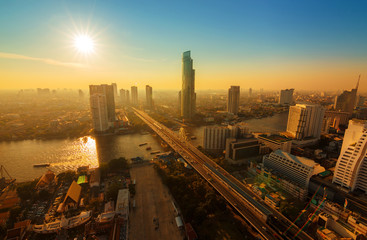Chao Phraya river and high building sky scrapper in heart of ban