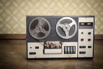 Old portable reel to reel tube tape-recorder, toned, with copysp