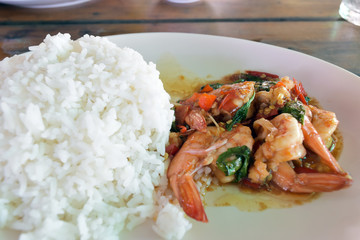 Rice with shrimps on dish in restaurant