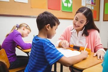 Happy teacher helping her students