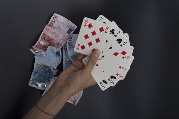 wasting money playing cards