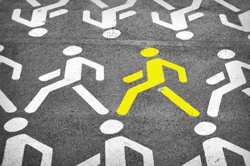 Pedestrian street sign on a gray asphalt road - yellow leader