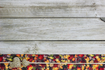 Blank rustic sign with autumn leaves and hearts border