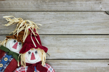 Blank rustic sign with boy and girl scarecrows