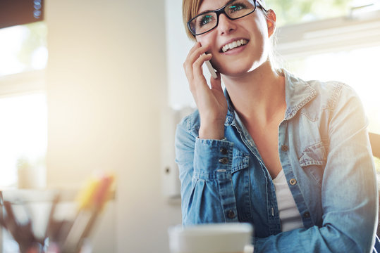 Office woman Talking to Someone on Phone