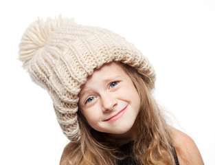 the little girl in hat with pompom