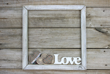 Rustic wood sign with LOVE and country fabric hearts