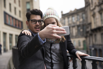 Couple using a Smart Phone to take a Selie.