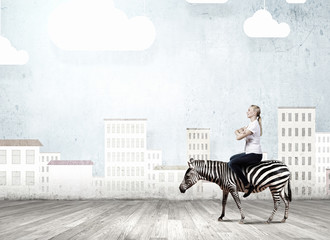 Fototapete - Woman ride zebra