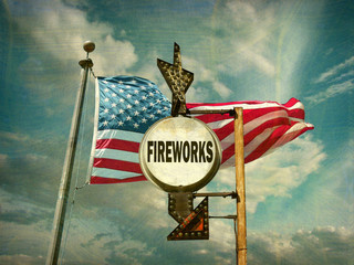 aged and worn vintage photo of fireworks sign and american flag
