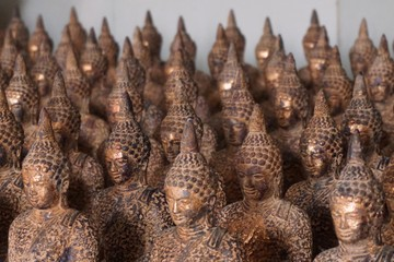 line up of image of Buddha
