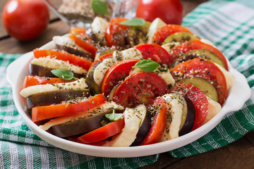 Prepared gratin dish raw eggplant with mozzarella and tomatoes