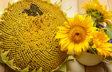 Sunflowers on the wooden table