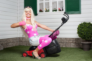 Barbie sitting on a lawn-mower