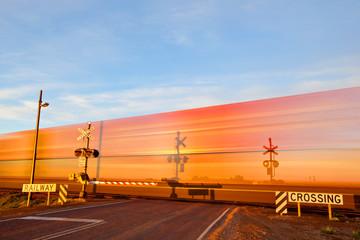 Blur of a train at a crossing. Pimba. South Australia.