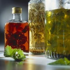 Still life with two herb vinegars & raspberry herb vinegar