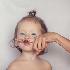 toddler posing with funny hipster mustache