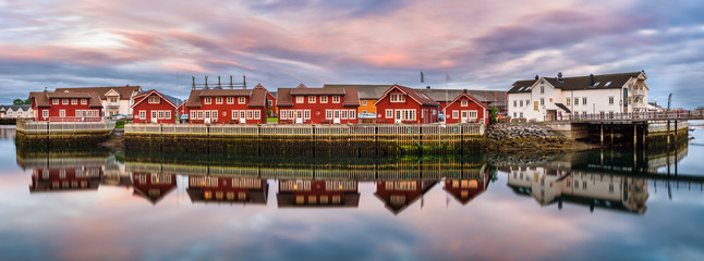 Wall Mural - Red harbor houses in Svolvaer, Norway at sunset