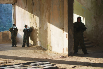 boys playing with gun during laser tag