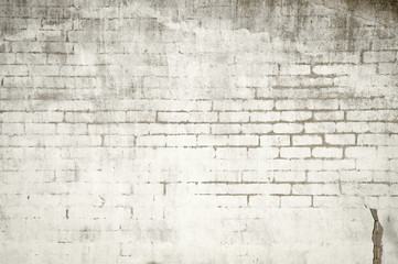 Muro de ladrillos con pintura sucia