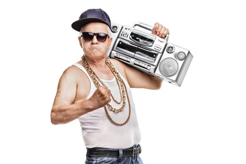 Mature man in hip-hop outfit holding a ghetto blaster Wall mural