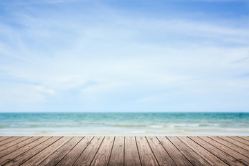wooden floor with sea and sky blurred background