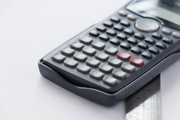 Calculator and Ruler on White Background