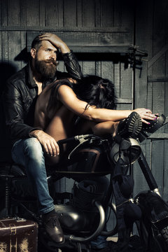 Biker and undressed woman
