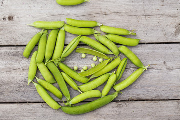 Green peas on wooden table