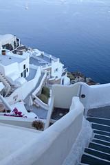 white buildings of Oia village at sunset, Santorini island, Gree