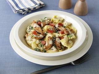 Tortellini Florentine style, with strips of sauteed turkey