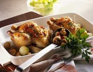 Spring chicken with pearl onions and mushrooms